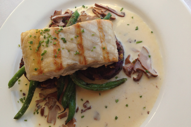 Grilled Columbia River Sturgeon with a chanterelle mushroom cream sauce at Alloro Wine Bar & Restaurant in Bandon, Oregon.
