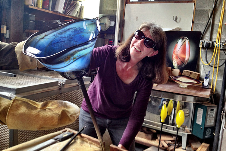 Glass artist Suzanne Kindland at Icefire Glassworks in Cannon Beach