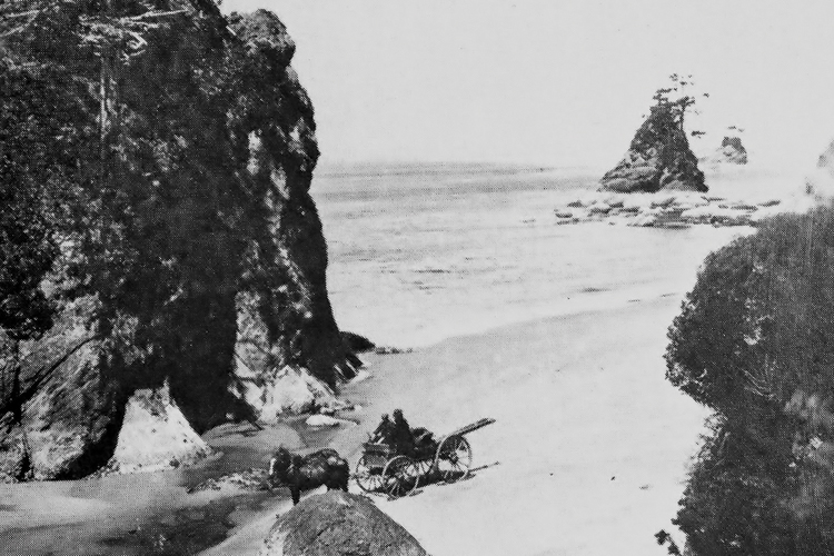 A horse-drawn wagon uses the beach for a travel route in the 1890s near Garibaldi.