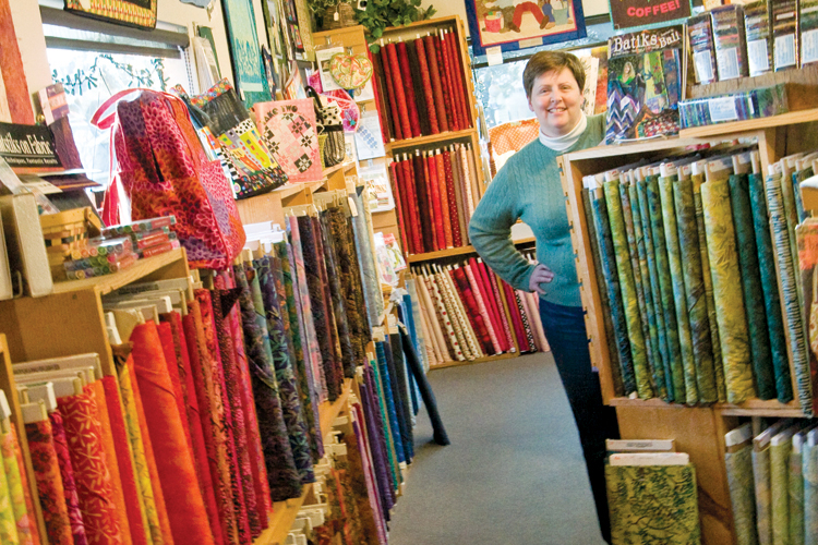 Owner Julie Walker of Center Diamond Fabrics in Cannon Beach fills her store with colorful batiks, contemporary designs and coastal related prints to the delight of quilters and textile artists.