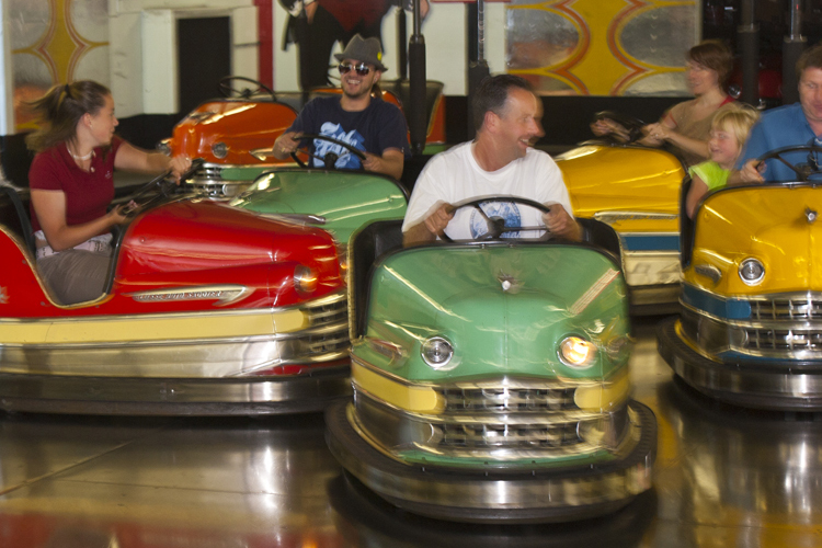 Fun times for families at Seaside's popular bumper cars on Broadway.