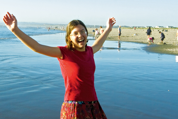 Luci Swim from Kansas won an essay contest sponsored by National Geographic Kids magazine last year and her prize was a trip to the Oregon coast with her family. Here, Luci enjoys her first encounter with the ocean on a beautiful day in Seaside.