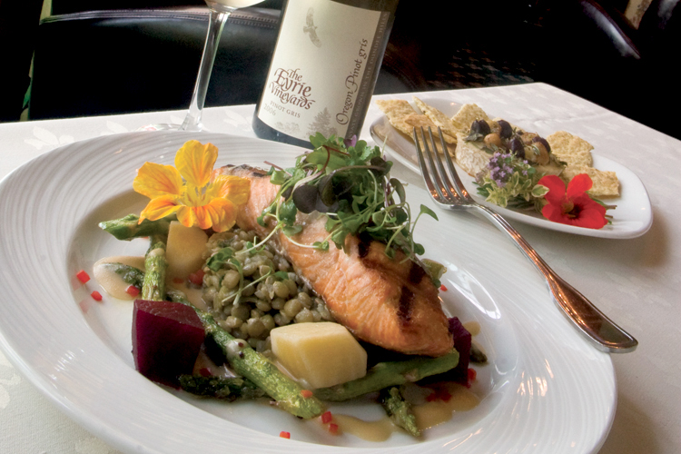 The summer menu at The Shelburne Inn Restaurant features grilled Chinook salmon with a light beurre blanc and a cold lentil salad enlivened with finely chopped cilantro.