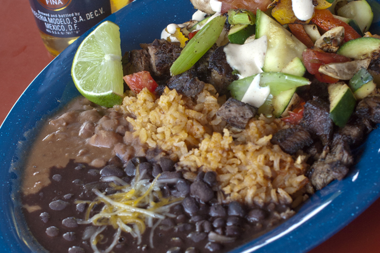 A flavorful, filling meal for under $9, the carne asada platter at The Stand in Seaside features grilled steak and vegetables with sides of rice and beans.