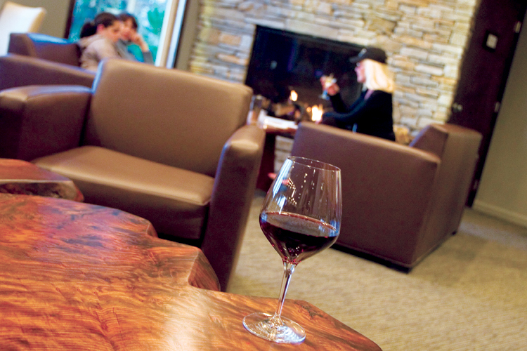 The lounge at The Bay House in Lincoln City offers an award-winning wine selection, sophisticated bar menu, a cozy fireplace and a panoramic view of Siletz Bay.