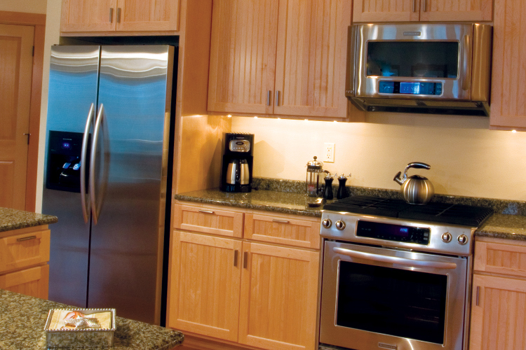 "According to Kay Covert from Windermere Manzanita, if your budget is tight, forget about remodeling the kitchen. ""There are few things as seductive as new appliances."""