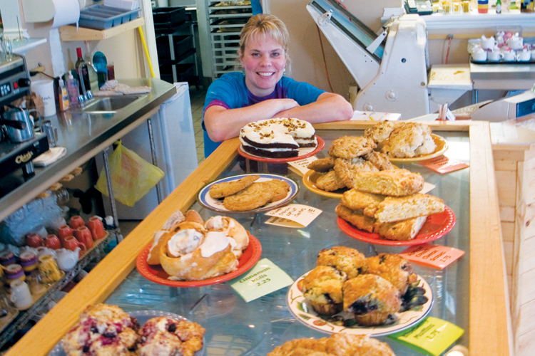 Robyn Barcroft, owner of Grateful Bread Bakery and Restaurant in Pacific City, pictured with her famous lineup of pastries and treats.