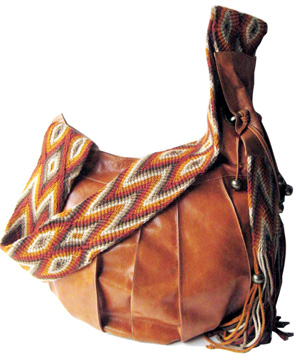 Unfurl In Manzanita Features A New Line Of Soft Lightweight And Exotic Handbags By Limon Piel Er Leather Intricately Crafted Shoulder Straps