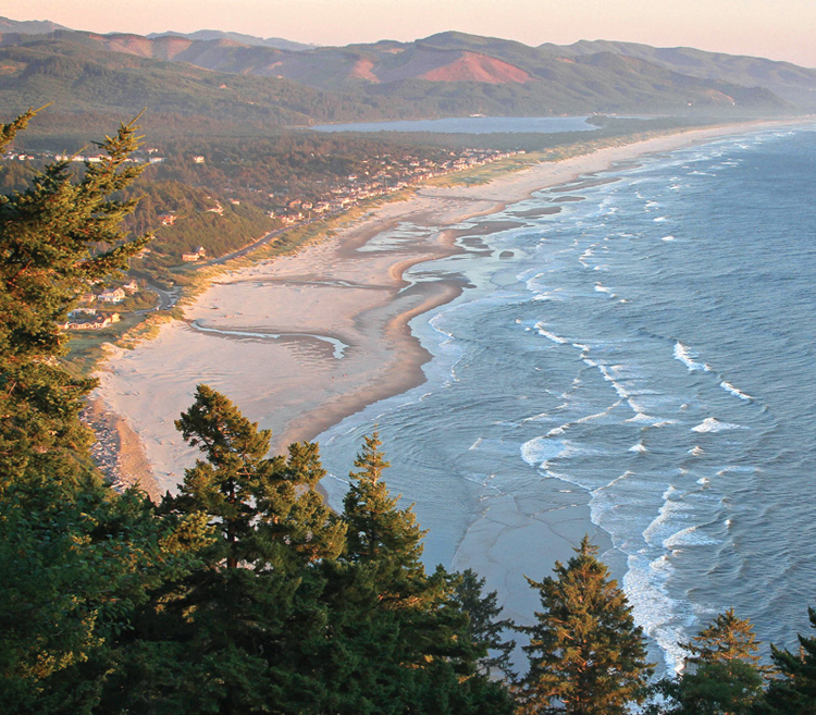 View of the beach at Manzanita with Nehalem Bay in the background from the Neahkahnie Mountain roadside turnouts on Highway 101