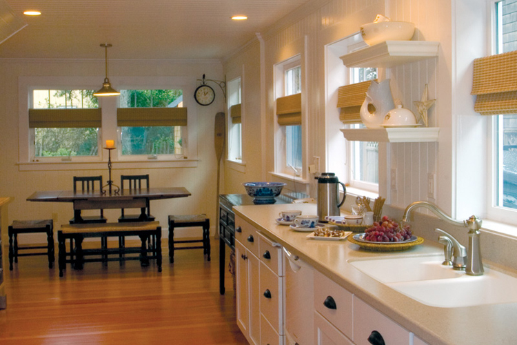 A cottage renovation mixes shades of white and blends old and new to create a clean and comfortable classic style.