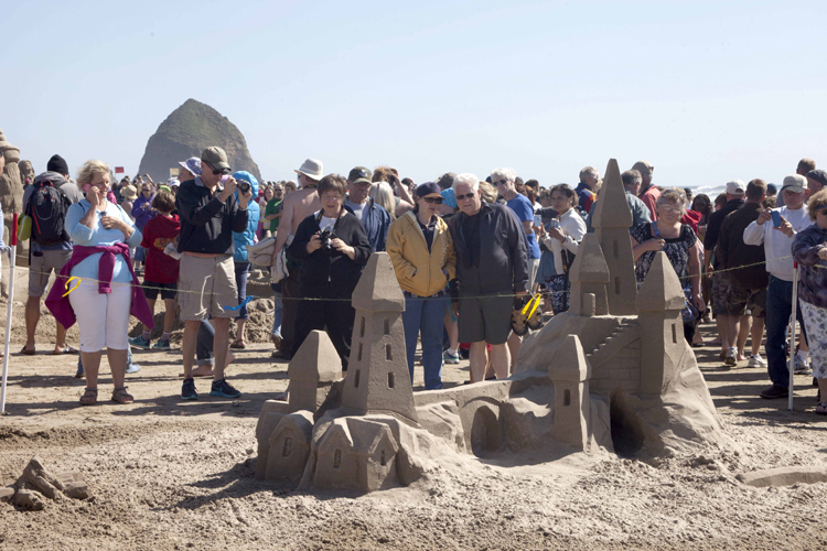 Spectators View Finished Sand Sculptures At Last Year