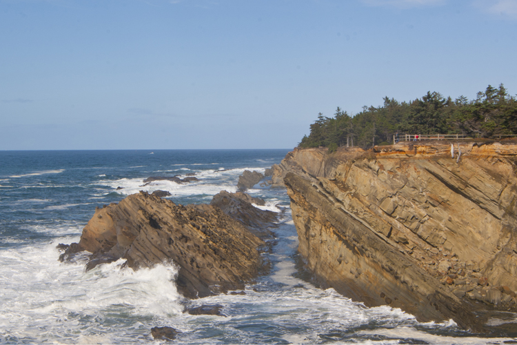 Cliffside paths offer exciting views of dramatic rock formations at Shore Acres State Park.